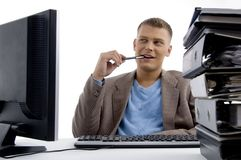 Young man sitting in office Stock Photo