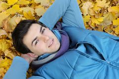Young man sitting in park. Stock Images