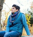 Young man sitting in park. Stock Photos
