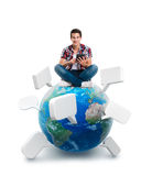 Young man sitting on a planet with a tablet. Isolated on white background Royalty Free Stock Photo
