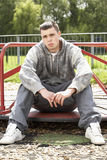 Young Man Sitting In Playground Royalty Free Stock Images