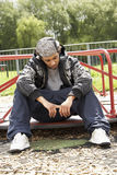 Young Man Sitting In Playground Royalty Free Stock Photos