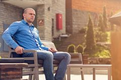 Young Man Sitting in a Restaurant - Portrait of a man waiting for his date.  Royalty Free Stock Photos
