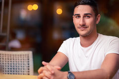 Young Man Sitting in a Restaurant Stock Photos