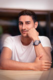 Young Man Sitting in a Restaurant Royalty Free Stock Images