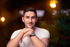 Young Man Sitting in a Restaurant Stock Images