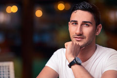 Young Man Sitting in a Restaurant Royalty Free Stock Image