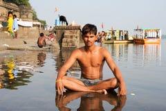 Young man sitting on sacred river Narmada at Maheshwar Royalty Free Stock Image