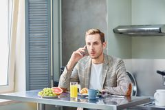 Calling by breakfast Royalty Free Stock Photos