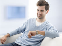 Young man sitting on sofa Stock Photo
