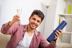 Young man sitting on the sofa Stock Photography