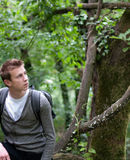 A young man sitting in a spring forest Stock Images