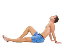 Young man sitting and sunbathing Royalty Free Stock Photos