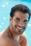 Young man sitting in swimming pool Stock Images
