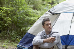 Young Man Sitting By Tent Royalty Free Stock Images