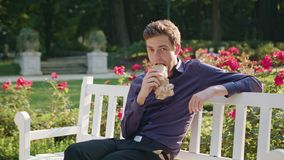 Young Man Having a Snack in the Park Royalty Free Stock Photos