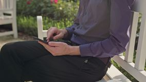 Young Man in the Park Using a Phone Stock Image