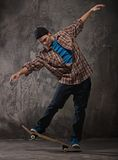 Young man on skate Stock Images