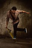 Young man on skate Stock Photos