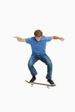Young man on a skateboard. Against a white background Stock Photo
