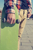 Young man with a skateboard Royalty Free Stock Photos