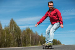 Young man with skateboard Stock Photography