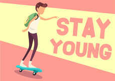 Young man on skateboard stay young. Concept of  Young man on skateboard stay young Stock Photos