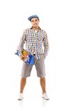 Young man with skateboard Stock Images
