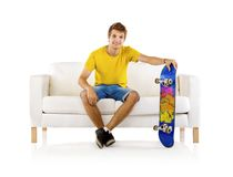 Young man with skateboard Stock Image