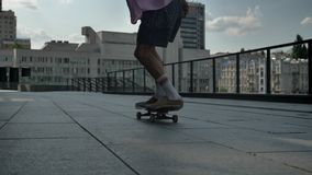 Young man skateboarder doing skateboard trick in daytime in summer, sport concept, urban concept.  stock video