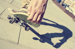 Young man skateboarding, with a filter effect Royalty Free Stock Images