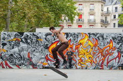 Young man is skateboarding at Place de la Republique in Paris Royalty Free Stock Images