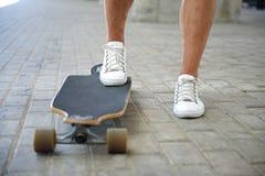 Young man skateboarding on street Stock Photo