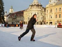 Young man skating on ice skating rink Stock Photography