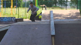 Young man is skating on skateboard in skate park. Extreme, sport concept stock footage