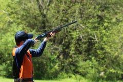 Young man skeet shooting Royalty Free Stock Photo