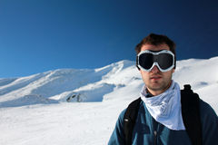 Young man at ski. Portrait of a young man with ski-goggles in the mountains Royalty Free Stock Image
