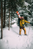 Young man with ski walking in the snow forest. Young man with ski walking in the snowy winter forest Stock Photography
