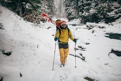 Young man with ski walking in the snow forest. Young man with ski walking in the snowy winter forest Royalty Free Stock Photos