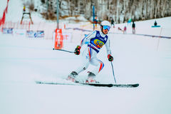 Young man skier after finish spray of snow during Russian Cup in alpine skiing Stock Photo