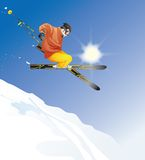 Young man skiing. Jumping in the air Royalty Free Stock Photo