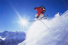 Young man skiing. Jumping in the air royalty free stock images