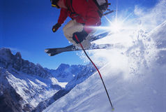 Young man skiing. Jumping in the air