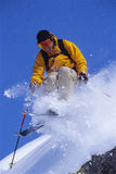 Young man skiing. With smile on face Stock Photography