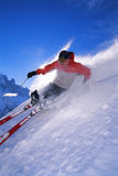Young man skiing. On the slopes stock photo