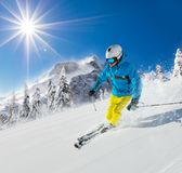Young man skiing downhill in Alps Stock Images