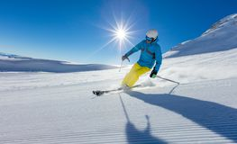 Young man skiing downhill in Alps Stock Photo