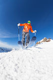 Young man skiing in motion view from below Royalty Free Stock Photos