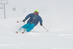 Young man skiing in snowstorm Royalty Free Stock Photography