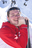 Young man skiing. Sportsman taking a deep breath after skiing Royalty Free Stock Image